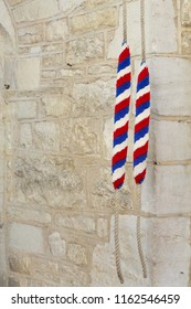 Ropes for ringing bells in an ancient church in England, UK. With copyspace, depicts campanology and christianity