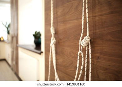 ropes for stretching and physical training. Kurunta yoga class.