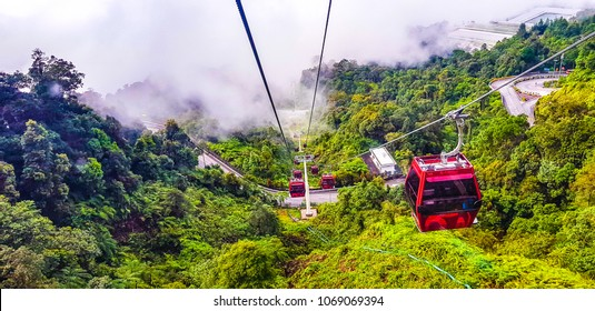 in a ropeway cable car going down from genting highlands to kualampur