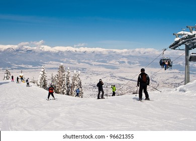 Rope-way lifting skiers to mountain-skiing lines on mountain Todarko, a resort of Bansko, Bulgaria
