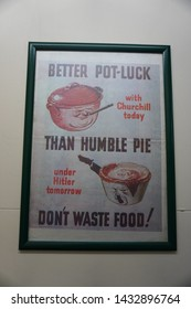 "Ropley, Alresford/UK - May 27 2019: A photo of a poster used in WW2 in England. ""Better pot-lock with Churchill today than humble pie under Hitler tomorrow."""