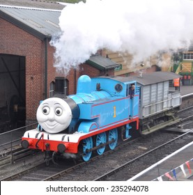 ROPLEY, UK - APRIL 7. Thomas the Tank Engine is a  steam locomotive based on books by the Reverend Wilbert Awdry, at the Watercress Line preserved railway on April 7, 2012 at Ropley, Hampshire, UK.