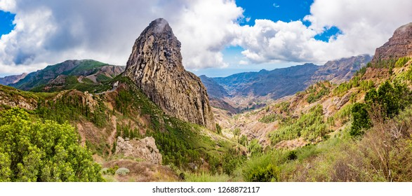 Roque Agando, a dramatic volcanic plug, in the highlands of La Gomera, Canary Islands, Spain.  A symbol of the island and with a Guanche shrine, the original inhabitants, on the summot