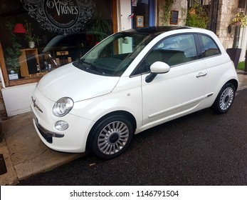 Roquebrune-Cap-Martin, France - July 16, 2018: Badly Parked Car. White Fiat 500 (Side View) Parked in The Street Of Roquebrune Cap Martin On The French Riviera