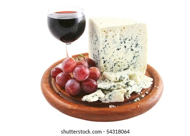 roquefort cheese and wine glass with grapes