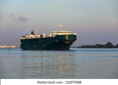 Ro-ro freight ship leaving Hamburg on the Elbe river
