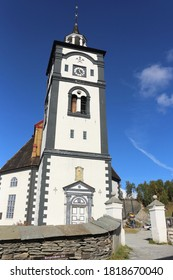 ROROS, TRONDELAG COUNTY / NORWAY - SEPTEMBER 08 2020: Protestant church of Roros. Church bell tower in the copper mines town of Roros, Norway.