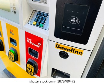 Ros, CA - December 5, 2020: Tap to Pay scanner at a gas station pump allows customers to use debit and credit cards without touching or inserting their cards.