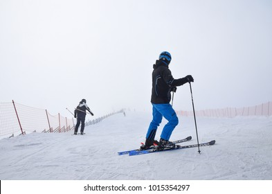 "Rosa Khutor, Sochi, Russia, January, 26, 2018. Skiers descend from the ski slopes ""Triton"" in reduced visibility in heavy fog on ski resort Rosa Khutor"