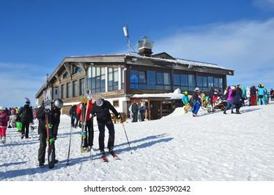 "Rosa Khutor, Sochi, Russia, January, 26, 2018. People walking near Restaurant ""Altitude"" on Rosa Khutor ski resort"