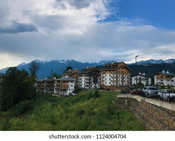 Rosa Khutor, Sochi, Russia, June 2018: Olympic village, ski resort in sunny day. Krasnaya Polyana. Hotel and cable car in summer season. World class built for the 2014 Olympics. Editorial use only.