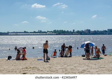 ROSARIO, ARGENTINA - JANUARY 08, 2015: People have fun in the beach of Parana River.