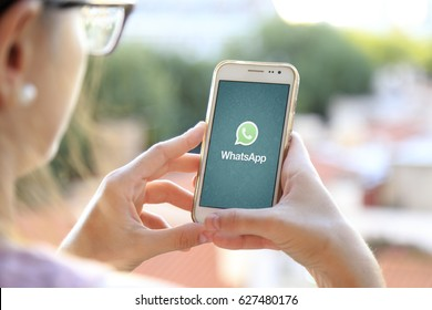 ROSARIO, ARGENTINA - JANUARY 19, 2017: Girl holding a smartphone with Whatsapp application on the screen. Young woman. Millennial. Communications.