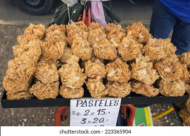 Rosario, Argentina - October 12, 2014: Traditional Argentinian fried cakes made of puff pastry and stuffed with sweet potato jelly are on sale on the sidewalk on October 12, 2014 in Rosario, Argentina