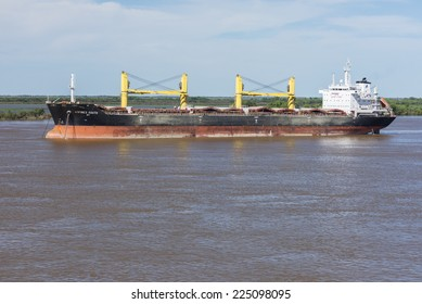 ROSARIO, ARGENTINA - OCTOBER 20, 2014. The Adfines South bulk carrier ship is anchored at the Parana river in Rosario city, Argentina