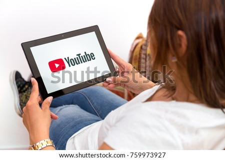 ROSARIO, ARGENTINA - OCTOBER 28, 2017: Girl at home watching a tablet with youtube on the screen. Young woman. Millennial. Communications. Video streaming.