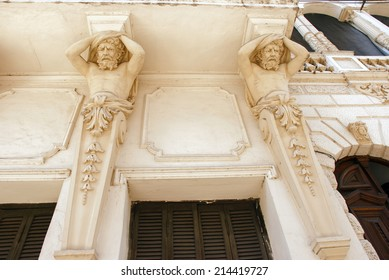 ROSARIO, SANTA FE, ARGENTINA - SEPTEMBER 24, 2011: Sculptures of men as ornamentation on the front of an old building on september 24, 2011 in Rosario, Santa Fe province, Argentina.
