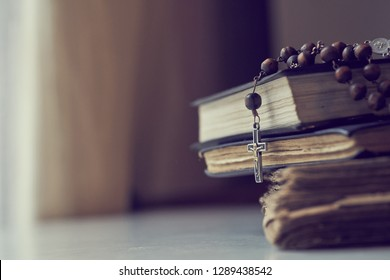 The rosary beads on Catholic Church liturgy books.