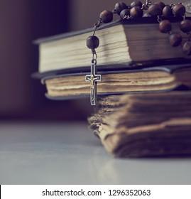 The rosary beads on Catholic Church liturgy books.