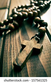 rosary beads on wooden table