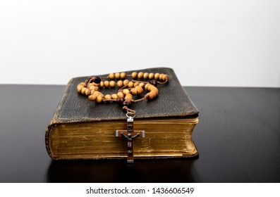 Rosary beads and prayer book. Rosary and book of Catholic Church liturgy.