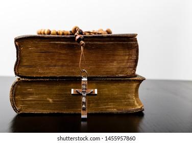 Rosary beads and prayer books. Rosary and books of Catholic Church liturgy.