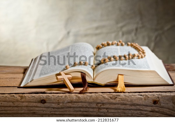 rosary with bible on the desk