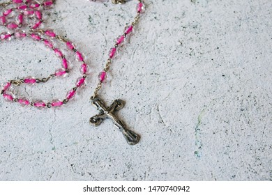 Rosary necklace in the white background
