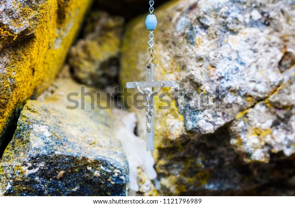 Rosary on stone wall