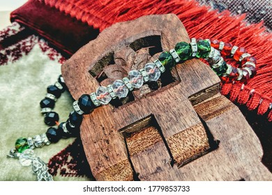 Rosary or tasbih with praying mat rug. Selective focus and natural light. Image maybe contain noise or blur. Islamic concept.