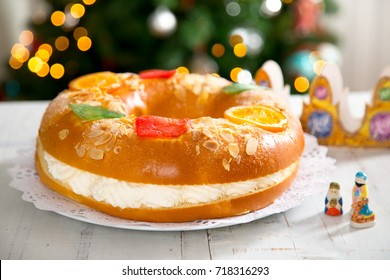 """Roscon de reyes"" , Spanish typical dessert of Epiphany, with cream filling"