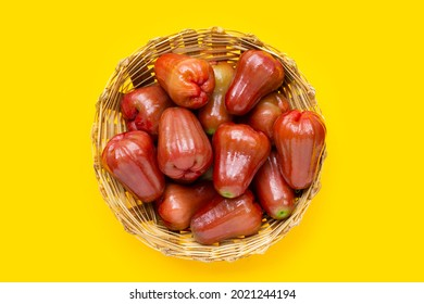 Rose apple in bamboo basket on yellow background