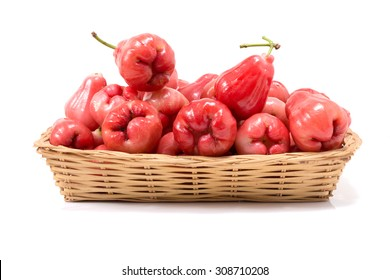 Rose apple in basket on white background.