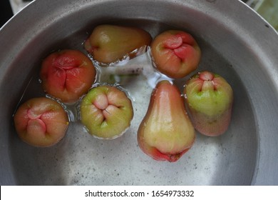 rose apple on water in pot