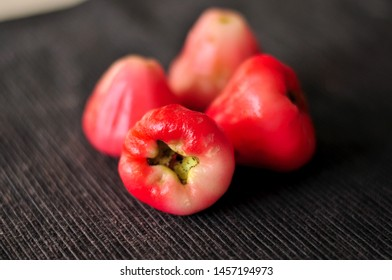 Rose Apple (wax apple) fruits close-up. Syzygium jambos is a tree originating in Southeast Asia and occurring widely elsewhere, having been introduced as an ornamental and fruit tree.