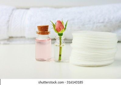 Rose attar cleaning tonic water fresh flower white cotton pads and towel, empty space, soft focus, bathroom daily care