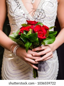 Rose bouquet held by one unrecognizable teenage girl getting ready for prom