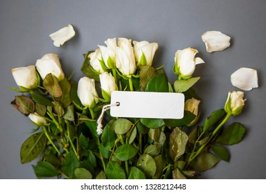 Rose bouquet with label card, mother's day or women's day greeting top view with blank label card, copy space card