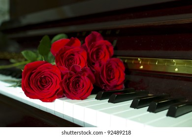 rose bouquet on a piano keyboard