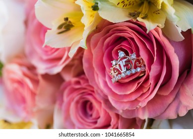 rose bouquet with quinceanera ring