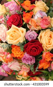 Rose bouquet in various briht and pastel colors after a rain shower