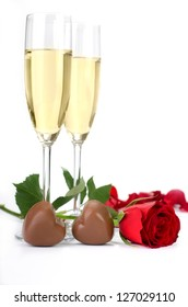 Rose, champagne and chocolates on a white background