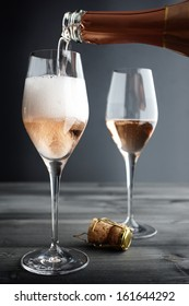 Rose Champagne, Pink Champagne being filled into Glass, selective focus