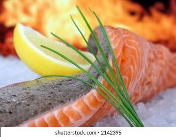 Rose colored fish steak, summer food with wine and lemon marinade macro closeup