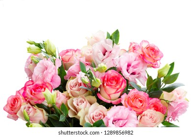 Rose and eustoma fresh flowers bouquet in two shades of pink isolated on white background