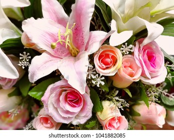Rose fake flower and Floral background. rose flowers made of fabric. The fabric flowers bouquet. Colorful of decoration artificial flower