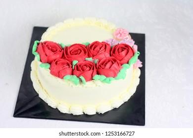 Rose flower buttercream decoration on cake