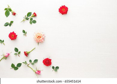 Rose flowers. Flowers composition made of fresh roses flowers.  Flat lay, top view with blank space on right side