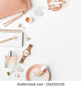 Rose gold styled feminine home office workspace. Flat lay, top view.