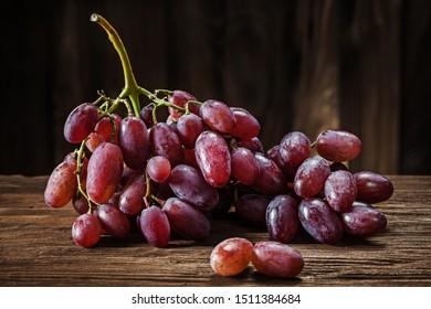 rose grape bunch on vintage wooden background